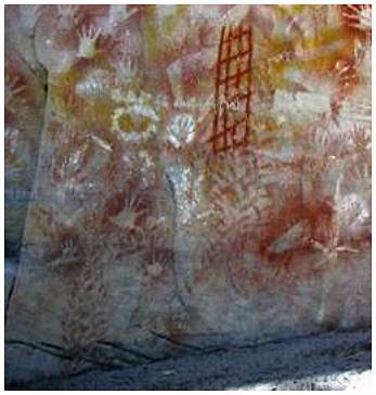 Aboriginal stencil and freehand art at Cathedral Cave in Central Queensland; estimated to be up to 500 years old.