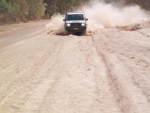 Vehicle on gravel road
